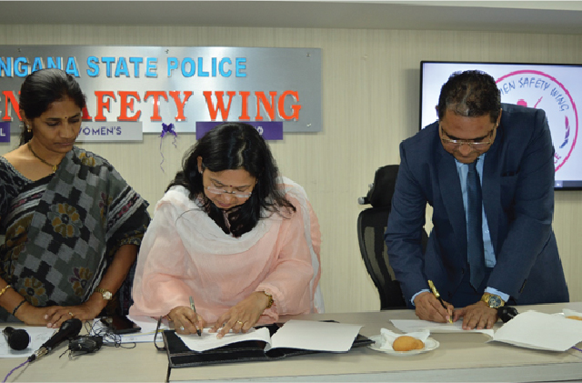 C:\Users\Dr CH RajiReddy\Desktop\Legal Aid Cell\MoU signing with Women Safety Wing\DSC_0318.JPG